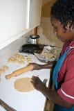 African Woman prepares Chapati Stock Photos