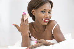 African woman presenting Contraceptive Pill Royalty Free Stock Photos