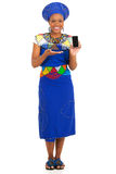 African woman presenting smart phone Royalty Free Stock Photography