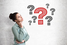African woman and question marks, concrete Stock Photos
