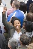 African Woman Raising Hand Stock Photo