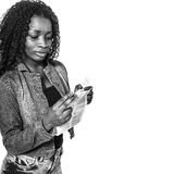 African woman reading. African american teen reading paper from medicine stock image