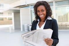 African Woman Reading Newspaper Stock Photos