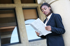 African Woman Reading Newspaper Stock Photo
