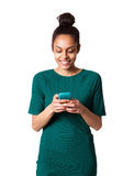 African woman reading text message on her mobile phone Stock Photos