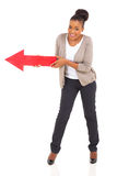 African woman red arrow Stock Images