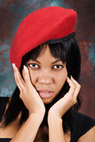 African woman in red beret Royalty Free Stock Image