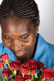 African woman with roses Royalty Free Stock Images