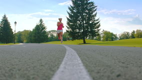 African woman running in park. Fitness woman running outdoor. Female runner stock video footage