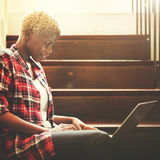 African Woman Searching Internet Sitting Steps Concept Royalty Free Stock Images