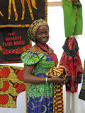 African woman. Selling textiles and fabrics to the suq in Genova in Italy Royalty Free Stock Photos