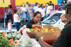 African woman sells vegetables Stock Photo