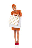 African woman shopping bags. Smiling african woman carrying two shopping bags on white background royalty free stock photography