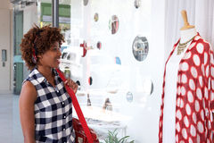 African woman shopping for clothes Royalty Free Stock Image