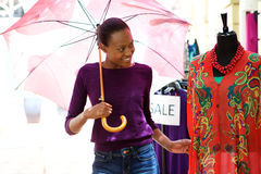 African woman shopping for clothes at store Stock Photography