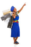 African woman shopping pointing Royalty Free Stock Photo