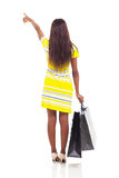 African woman shopping pointing Royalty Free Stock Photography