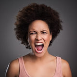 African Woman Shouting. Young African women shouting angrily Royalty Free Stock Image