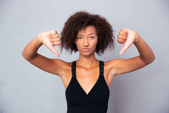 African woman showing thumb down Stock Image
