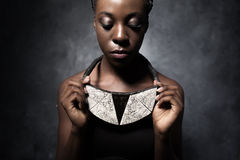 African woman shows a ceramic ethnic necklace Royalty Free Stock Images