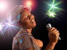 African woman singing. Stage performance of a young Ghanese woman singing stock photography