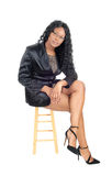 African woman sitting on chair. Royalty Free Stock Images