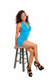 African woman sitting on chair. Royalty Free Stock Photography