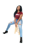 African woman sitting on chair. Stock Photos
