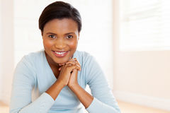 African woman sitting house Royalty Free Stock Photo