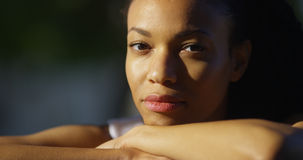 African woman sitting Royalty Free Stock Images