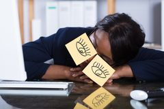 Woman Sleeping With Eyes Drawn On Adhesive Notes Royalty Free Stock Image