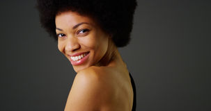 African woman smiling in black dress looking at camera Stock Photography