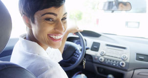 African woman smiling in car Royalty Free Stock Photo