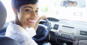 African woman smiling in car Royalty Free Stock Photos