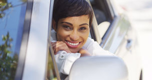 African woman smiling and looking out of car window Royalty Free Stock Photo