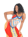African woman standing in dress. Stock Photo