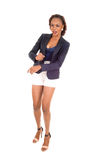 African woman standing in white shorts. Royalty Free Stock Photo