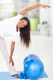 African woman stretching Stock Photo