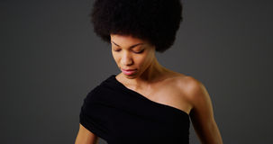 African woman in stylish black dress Stock Images