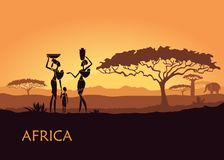 African woman on sunset background. African landscape with local women and children Stock Photo