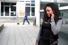 African woman talking on her mobile in the street Stock Photography