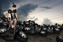 African woman on tires Stock Images