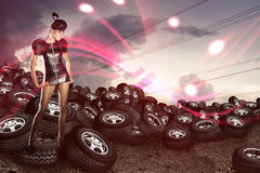 African woman on tires on the cloudy sky Stock Photography