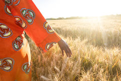 African woman in traditional clothes walking with her hand on a Royalty Free Stock Photo
