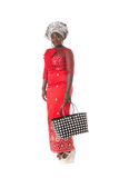 African woman in traditional clothing with tote bag.Isolated Stock Photos