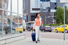 African woman with travel bag and smartphone Stock Image