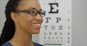 African woman trying on her new glasses Stock Images