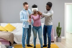 African woman trying on virtual reality glasses for the first time stock image