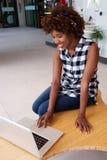 African woman using laptop computer Stock Photos