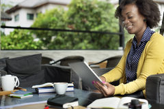 African Woman Using Tablet Relaxation Concept Stock Photography